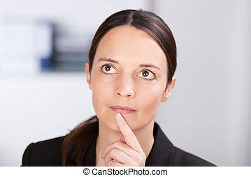 Thoughtful woman planning a business strategy