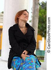 Thoughtful Woman Sitting at Column