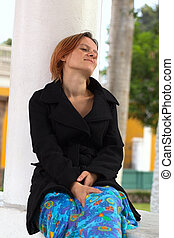 Thoughtful Woman Sitting at Column