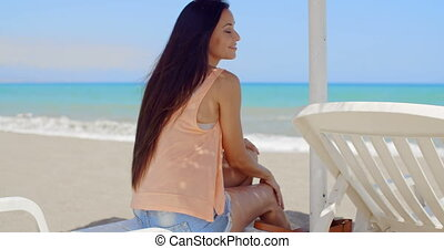 Thoughtful Woman Sitting on Beach Sun Lounger - Thoughtful...