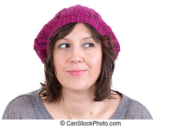 Thoughtful woman smiling in anticipation