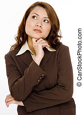 Thoughtful woman - A young attractive businesswoman is deep...