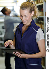 thoughtful woman with finger on tablet