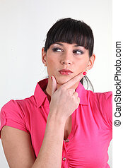 Thoughtful woman with her hand on her chin
