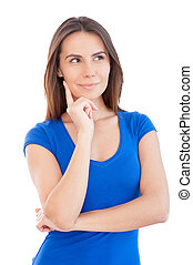 Thoughtful young beauty. Beautiful young woman holding hand on chin and looking away while standing isolated on white