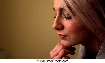 Thoughtful young blonde sitting on