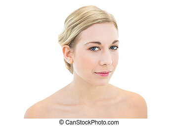 Thoughtful young blonde woman looking at camera