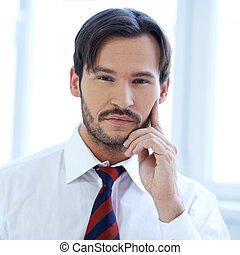 Thoughtful young businessman