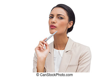 Thoughtful young businesswoman hold