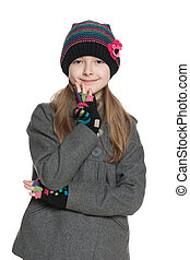 Thoughtful young girl in autumn clothing