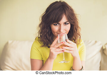 Thoughtful young woman drinking white wine