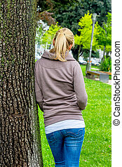thoughtful young woman from behind - portrait of a...