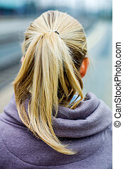 thoughtful young woman from behind