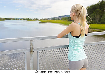 Thoughtful young woman rests after training - Beautiful...