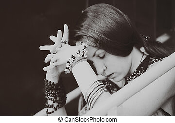 Thoughtful young woman with closed eyes