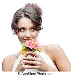 thoughtful young woman with flower in hair