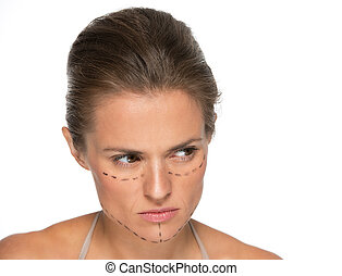 Thoughtful young woman with plastic surgery marks looking on copy space