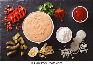 Thousand Island Dressing with ingredients on the table. Horizontal view from above