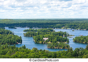Thousan islands, Canada-august 4,2015:View from the tower of the Thousen Islands Natural Park landscape on the St. Lawrence River in Ontario, Canada during a sunny day