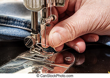 thread a needle in sewing machine
