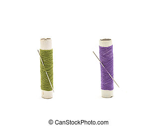 Thread and needle on white background.