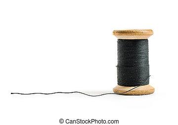 Thread bobbin isolated on white background