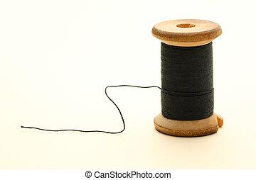 Thread bobbin on white background