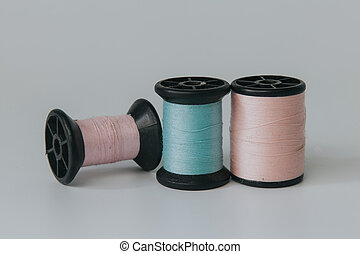 Thread bobbin on white background with vintage filter