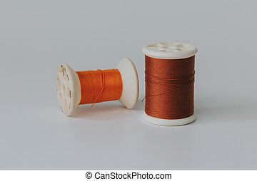 Thread bobbin on white background with vintage filter