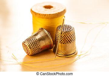 Thread bobbins and metal sewing thimbles