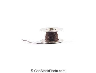Thread spool on white background