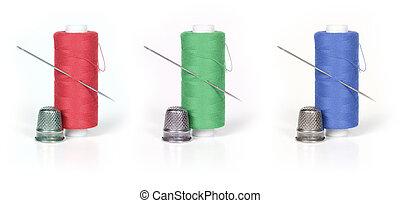 thread, thimble and needle