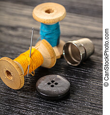 Thread with a thimble and button