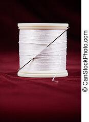Thread with needle