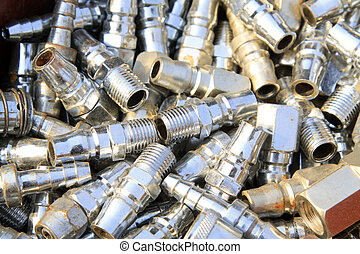 Threaded stainless steel pipe fittings piling up in together...