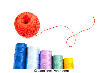 threads and red ball of yarn