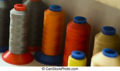 Threads are color. - Coil with color threads for sewing.