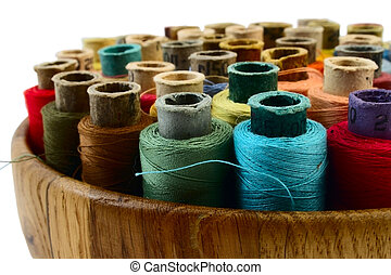 threads in wooden plate - coloured threads in wooden plate...