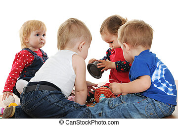 Threads of friendship - Four toddlers are playing with yarn ...