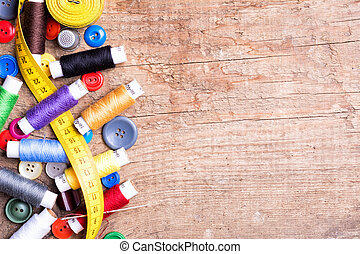 threads - Spools of threads and buttons on old wooden table
