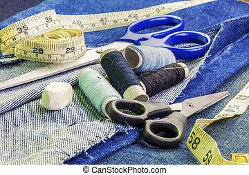 Threads with needles, scissors