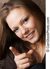 threatening and smiling beauty shaking her forefinger ;-)