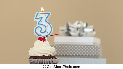 Three 3 candle in cupcake pastel background - Number three3...