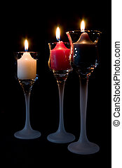 Candles burning in decorative candle holders