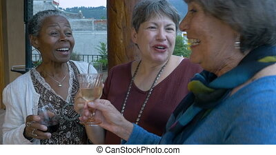 Three active healthy senior women laughing and celebrating...