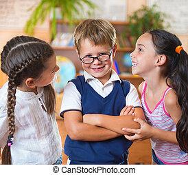 Three adorable schoolchildren having fun
