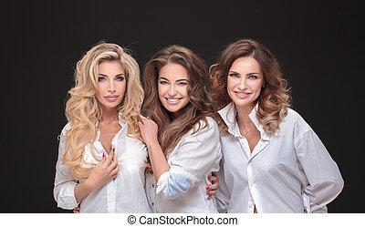 Three adult ladies posing.