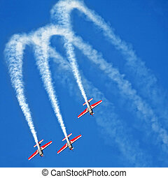three airplanes in formation on airshow - three airplanes...