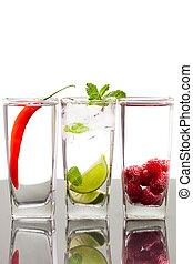 Three alcoholic beverages with fruits and berries - Three...