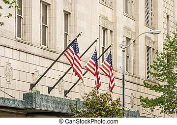 Three American Flags on Old Building